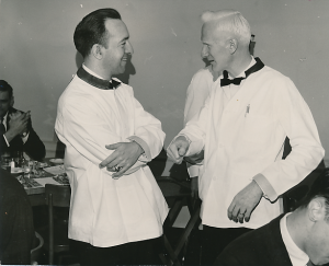 Ed Christman and Ed Wilson serving as waiters for a 1961 campus event to raise money for Ed Reynolds' tuition. Ed C was 32 years old.